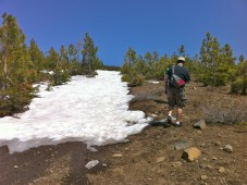 Darryl climbing Donner Peak trail, with vestiges of winter snow