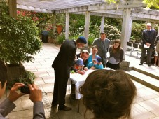 Emily and Joshua sign the marriage contract