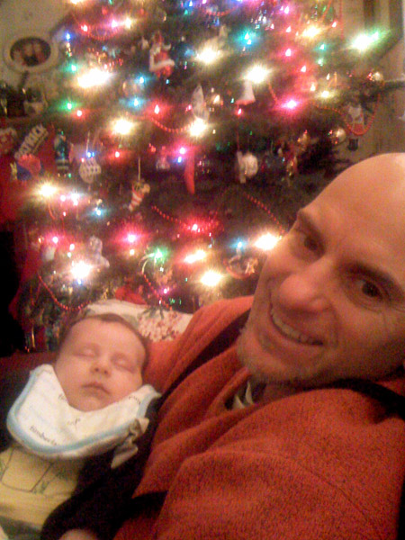 me and baby Noah in front of the Christmas tree, 2007