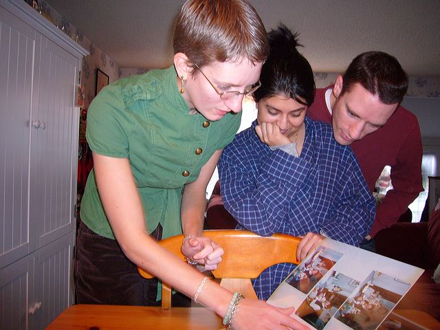 Emily, Neha, and Ian Anderson check out the rules