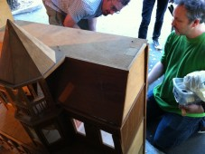 Lee shows off the features of the haunted doll house