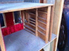 The hidden door behind the swiveling bookcase